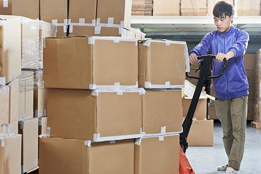 Man Moves Boxes in Business Storage Unit